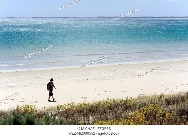 Australia, South Australia, Robe, woman walking on the beach