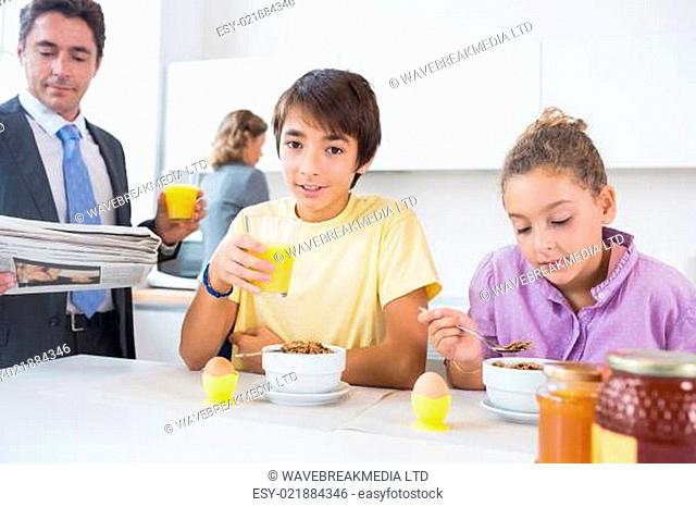 Cute family at breakfast time