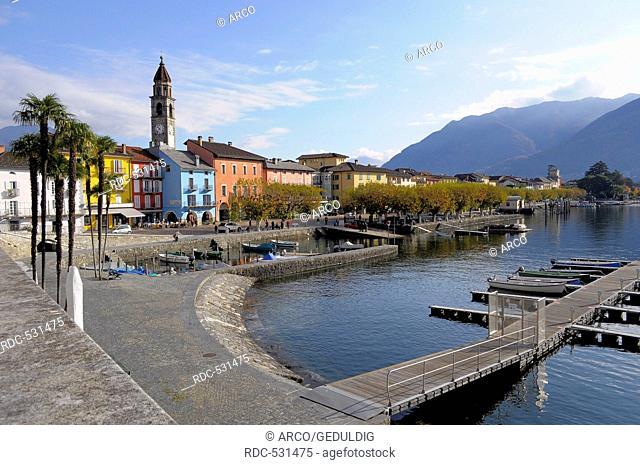 Boat harbor, church of Santi Pietro e Paolo, Lake Maggiore, Ascona, Ticino, Switzerland