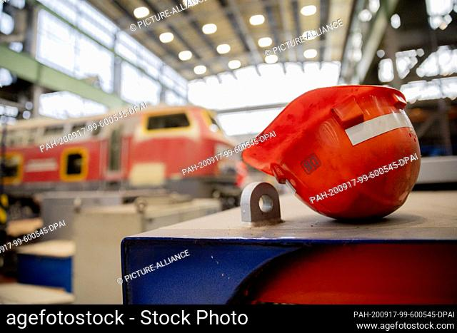 17 September 2020, Brandenburg, Cottbus: A helmet is placed in front of a locomotive when the development plans of Deutsche Bahn for the Lausitz region and the...