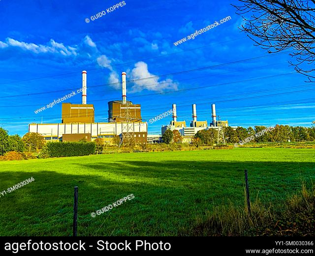 Brachterbeer, Netherlands. Rural, Polder Landscape with the Inudstrial Prince Claus Power Plant still working on Fossil Fuels