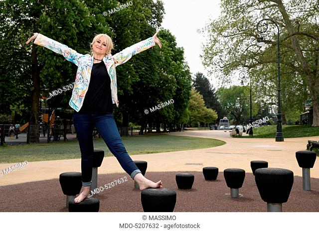 Actress and comedian Luciana Littizzetto with open arms inside the public park Parco del Valentino. Turin, Italy. 21st April 2016