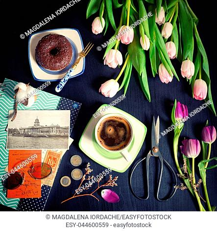 Vintage morning coffee and tulips on table