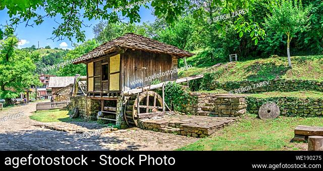 Water mill in the Etar Architectural Ethnographic Complex in Bulgaria on a sunny summer day. Big size panoramic photo