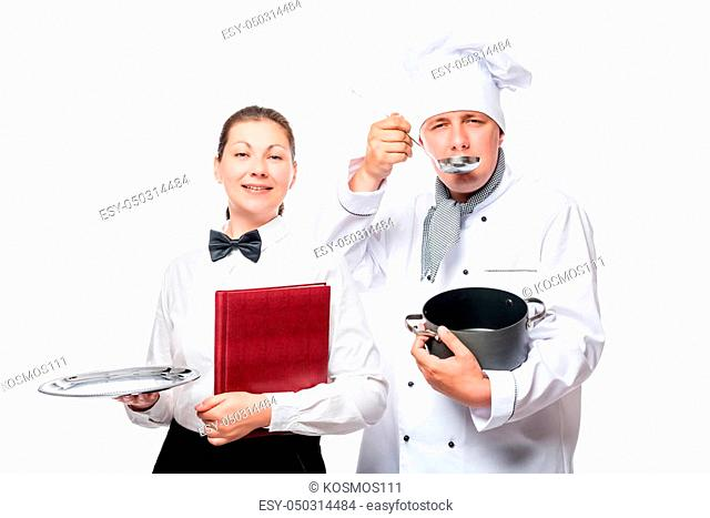 Cook tastes soup, the waitress holding an empty tray isolated