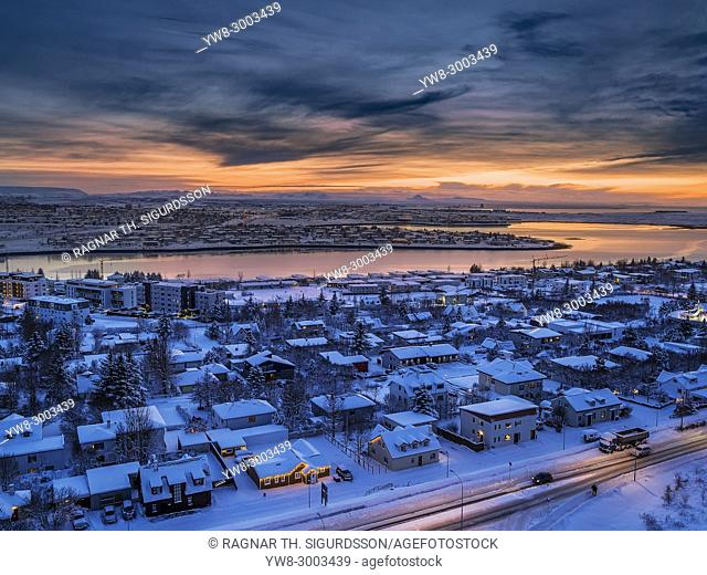 Homes in the wintertime in Kopavogur, a suburb of Reykjavik, Iceland. This image is shot using a drone