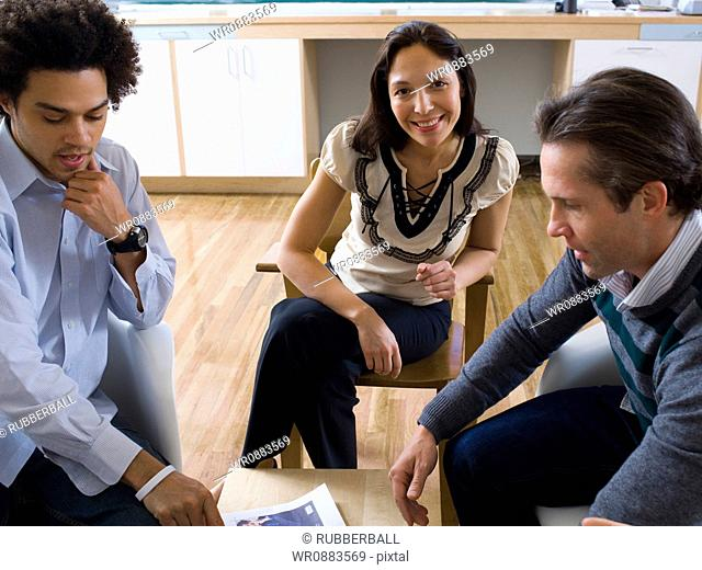 Three office workers having a meeting