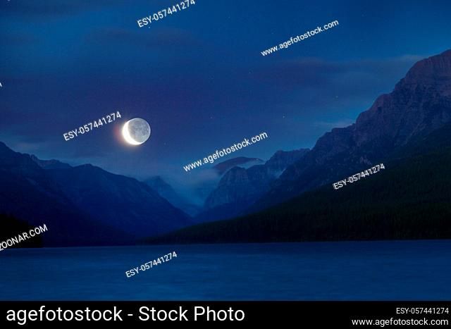 lake in mountains at night in moon light