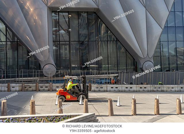 """Workers scurry about preparing """"""""The Shed"""""""" arts space in Hudson Yards for its opening, seen on Saturday, March 30, 2019 . (© Richard B. Levine)"""