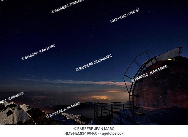 France, Hautes Pyrenees, Bagneres de Bigorre, La Mongie, Pic du Midi de Bigorre (2877m), starry sky and light pollution