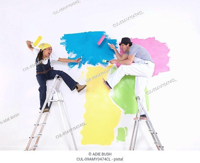 Couple posing on ladders