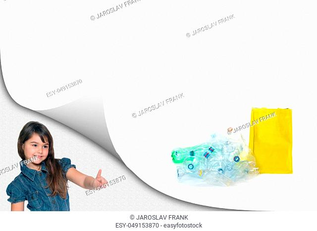 Cute little girl is showing a pile of sorted PET bottles waste with ready yellow bag on the white background ready for your text
