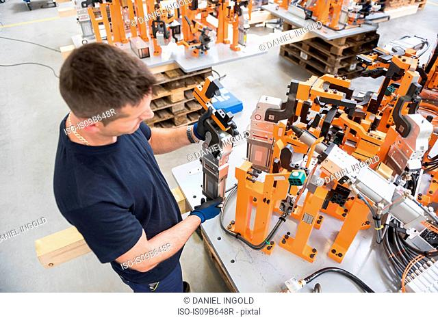 Factory worker looking at product in engineering factory