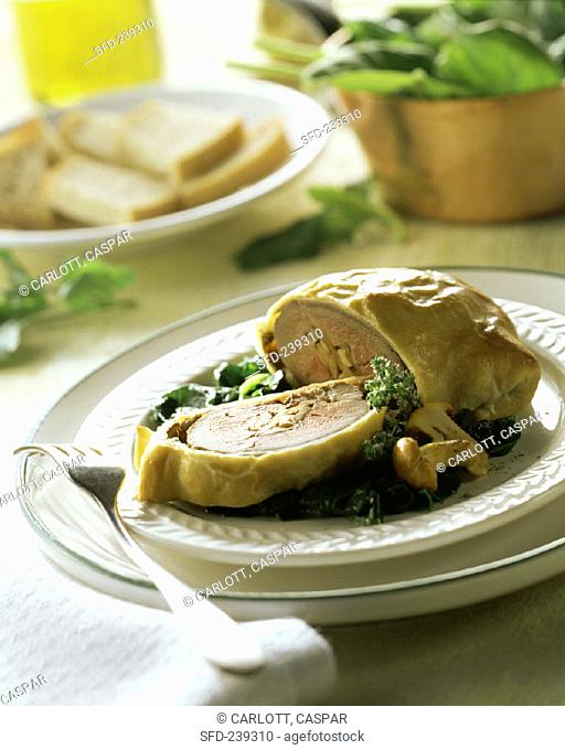 Pigeon in puff pastry with chanterelles and spinach