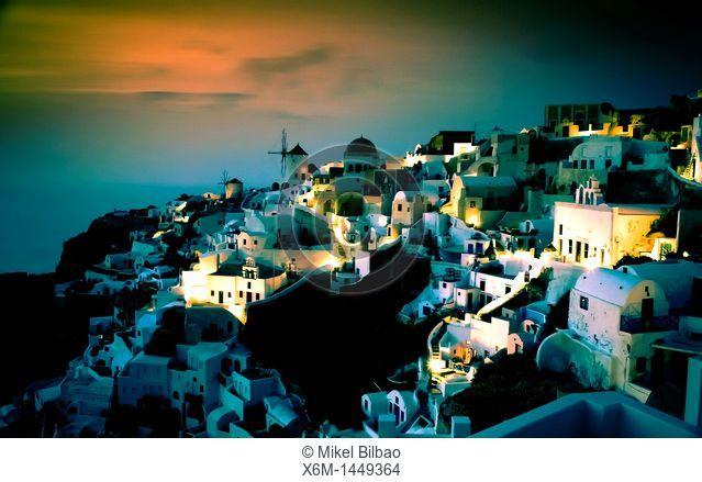 Oia village at sunset  Santorini island, Cyclades islands, Aegean Sea, Greece, Europe