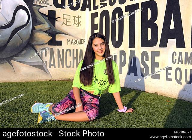 PUEBLA, MEXICO – DECEMBER 19: Actress Cassandra Iturralde poses for photos during the press conference 'Emma en Los Olivos' at  Los Olivos Football Club on...