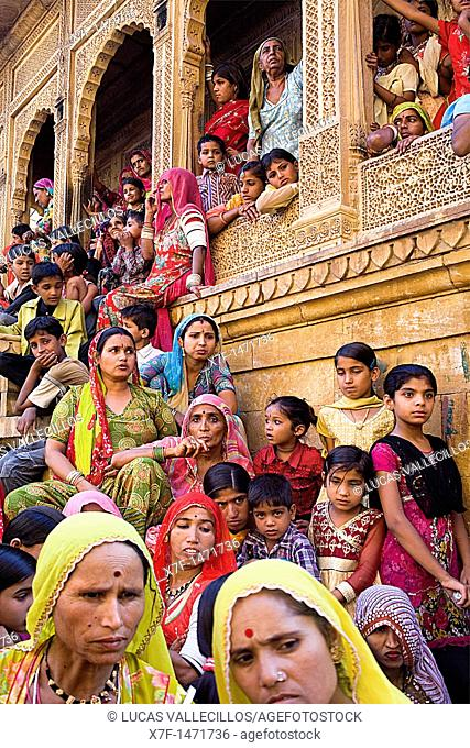 Gangaur festival,people watching a parade inside the Fort near Raj Mahal Royal Palace,Jaisalmer, Rajasthan, India
