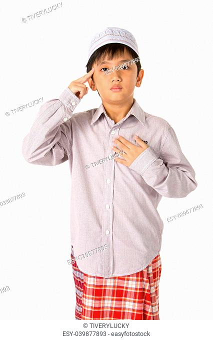 Islamic pray explanation. Asian child showing complete Muslim movements while praying