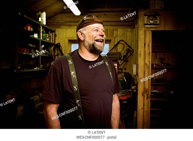 Laughing craftsman in his workshop
