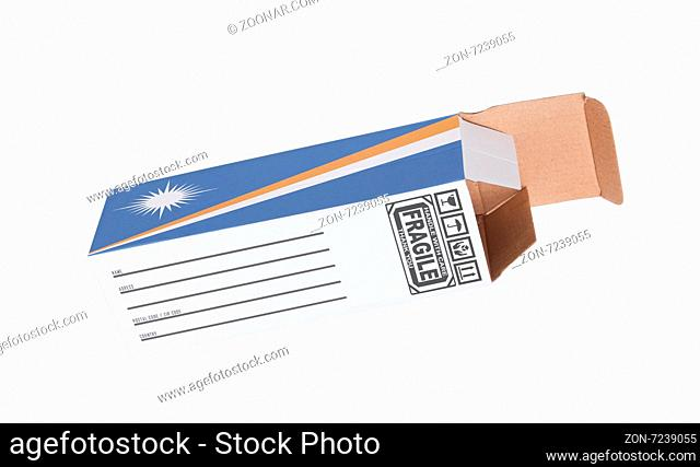 Concept of export, opened paper box - Product of Marshall Islands