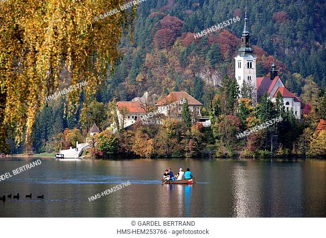 Slovenia, Gorenjska region, on the island of the Bled lake, church of the Assumption with the Julian Alps in the background
