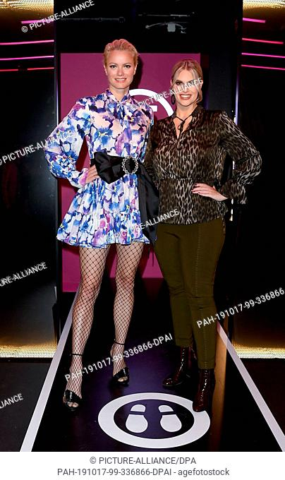 17 October 2019, Berlin: Franziska Knuppe (l) and Angelina Kirsch (both models) at the opening of the new fashion section at Madame Tussauds Berlin