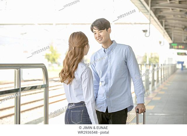 Young couple having a date at station