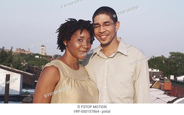 MS, Lockdown, Portrait of a couple on a rooftop terrace