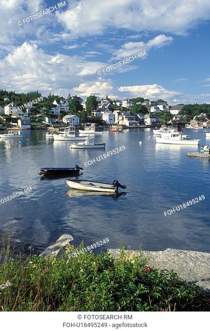 Stonington, ME, Deer Isle, Maine, Lobster boats buoyed in the harbor of the lobstering village of Stonington on Deer Isle on the Atlantic Ocean