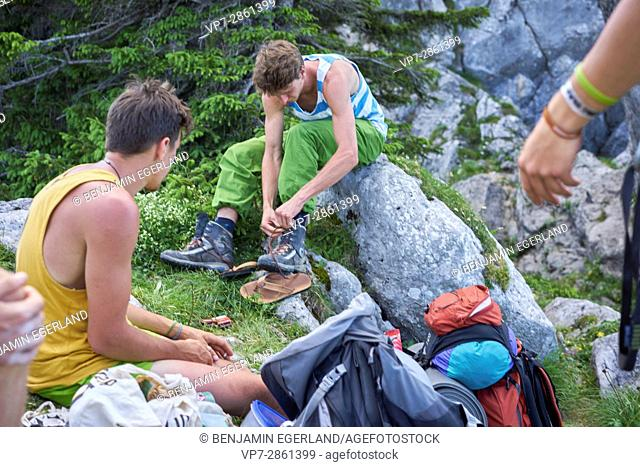 group of young climbers preparing adventure in Bavarian alps, near mountain Blankenstein, south of Germany