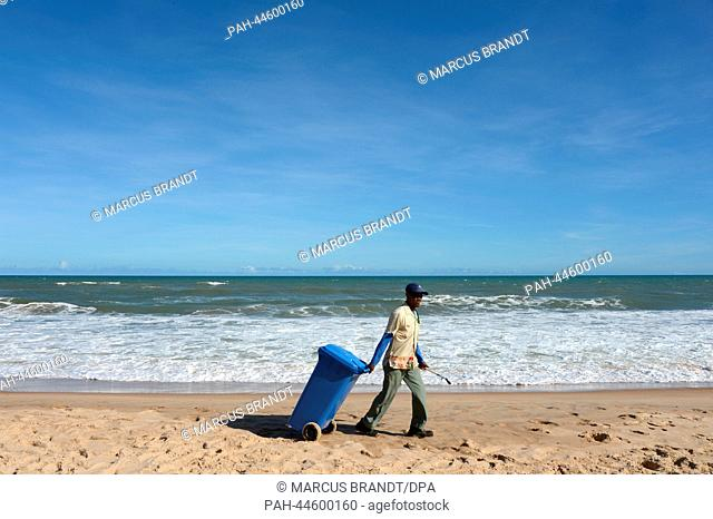 A cleaner walks on the beach in Costa do Sauipe, Brazil, 03 December 2013. The final draw for the preliminary round groups of the 2014 FIFA world cup Brazil...