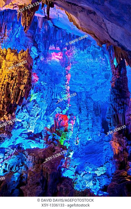 The beautifully illuminated Reed Flute Caves displaying the 'Singing Birds and Fragrant Flowers formation  Located in Guilin, Guangxi Provine, China