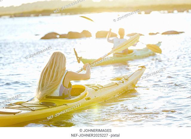 Women kayaking at evening