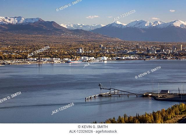 Aerial view of Point MacKenzie dock with Anchorage and the Chugach mountains in the background, Southcentral Alaska, USA