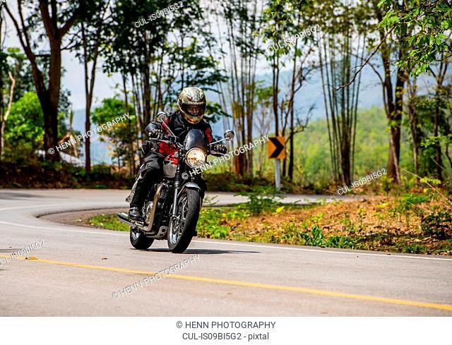 Man riding scrambler through a turn, Mae Hong Son loop, Thailand