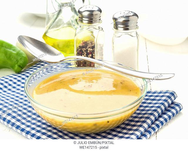 glass bowl cream vegetables on white wooden board