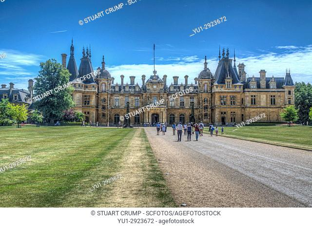 HDR image of tourists walking up the large gravel pathway towards Waddesdon Manor