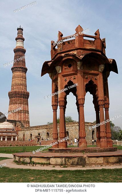 Smith's Folly and Qutb Minar built in 1311 red sandstone tower , Indo-Muslim art , Delhi sultanate , Delhi , India UNESCO World Heritage Site