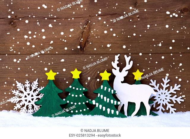Christmas Decoration With Reindeer On White Snow. Green Christmas Tree, Snowflakes. Brown, Rustic, Vintage Wooden Background For Copy Space