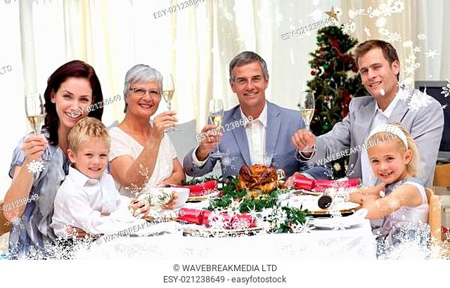 Composite image of family tusting in a christmas dinner with white wine