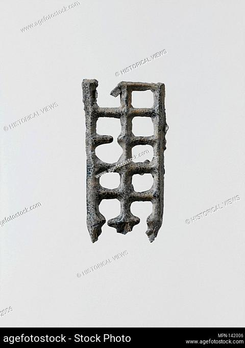 Lead grille. Period: Archaic; Date: 6th-5th century B.C; Culture: Greek, Laconian; Medium: Lead; Dimensions: Height: 1 1/2 in. (3