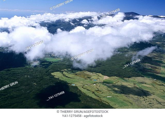 Aerial view of Cafres plain, Reunion Island (France), Indian Ocean.   Clouds are coming from west and wet trade wind of Indian Ocean