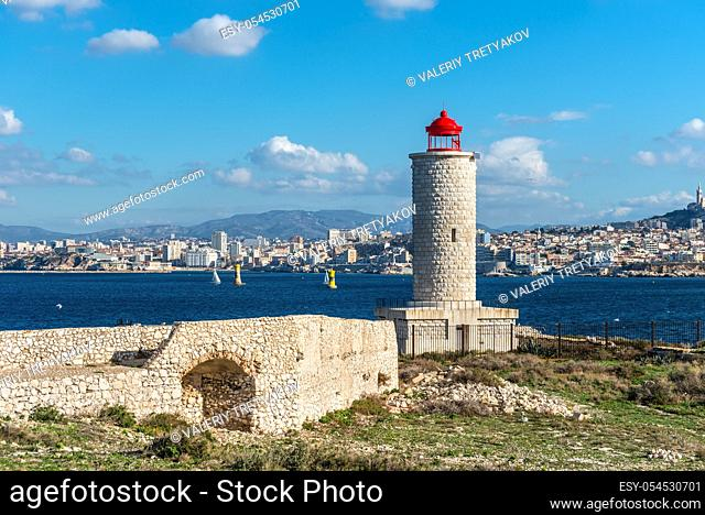 View on the Chateau d'If Lighthouse on Castle IF fortress-island with Marseille in the background, Provence, France. The chateau was made famous by the...