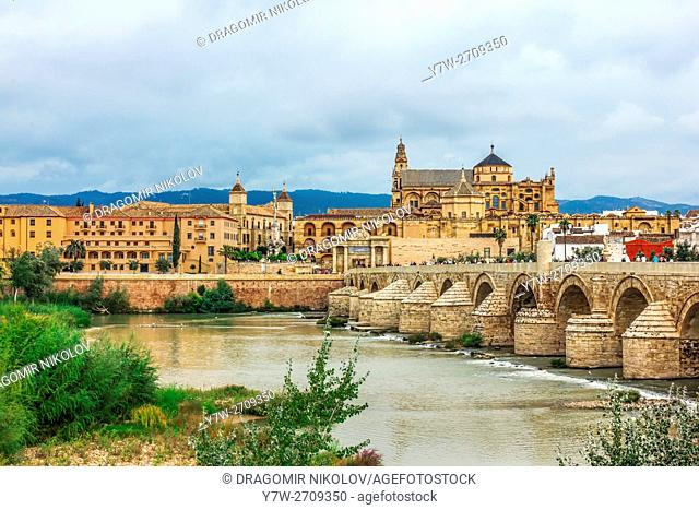 Roman Bridge on Guadalquivir river and Mezquita Cathedral (Great Mosque) at dawn in the city of Cordoba, Andalusia, Spain