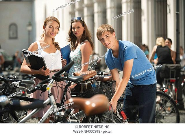 Germany, Munich, Young man and young women in university