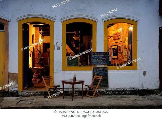 Inviting restaurant in Paraty's historic center; Paraty, Espirito Santo, Brazil. The beautiful colonial town of Paraty has been a UNESCO World Heritage Site...