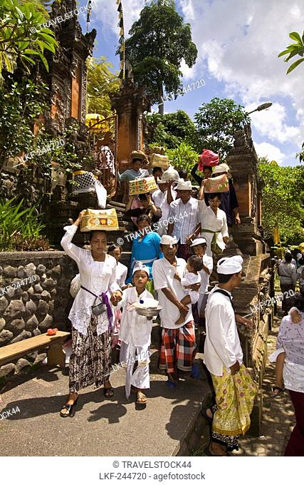 Hindus bringing offerings to Temple in Mas during Koningan Ceremoy, Bali Indonesia
