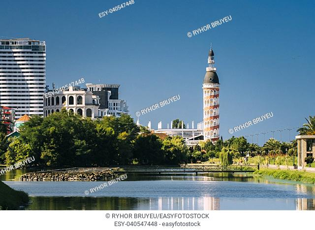 Batumi, Adjara, Georgia. New Multi-storey Residential House And Old Tower With Restaurant in Sunny Summer Day