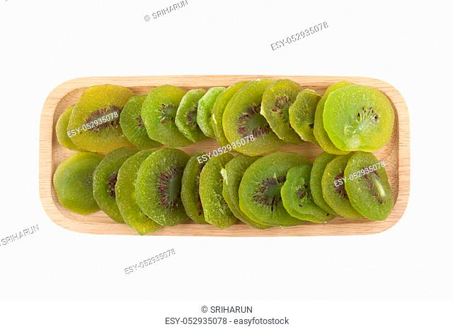 kiwi dried fruit in woodenware isolated on white background with clipping path