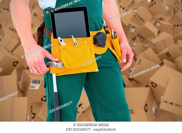 Composite 3d image of construction worker wearing tools belt